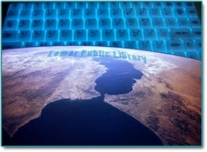 satellite image of part of the world, with glowing blue computer keyboard in background and words Lamar Public Library