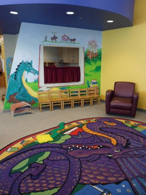 colorful rug and painted walls, with kid-sized wood chairs
