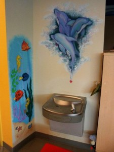 sea life and fairy murals at the water fountain
