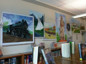 colorful paintings on display in the library